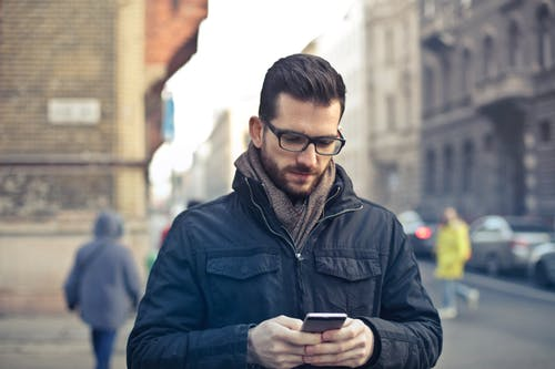 Man with smart phone doing psychotherapy online by video conferencing